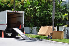 Picture of  Moving truck parked on Street With Ramp, Boxes And Household Furnishings